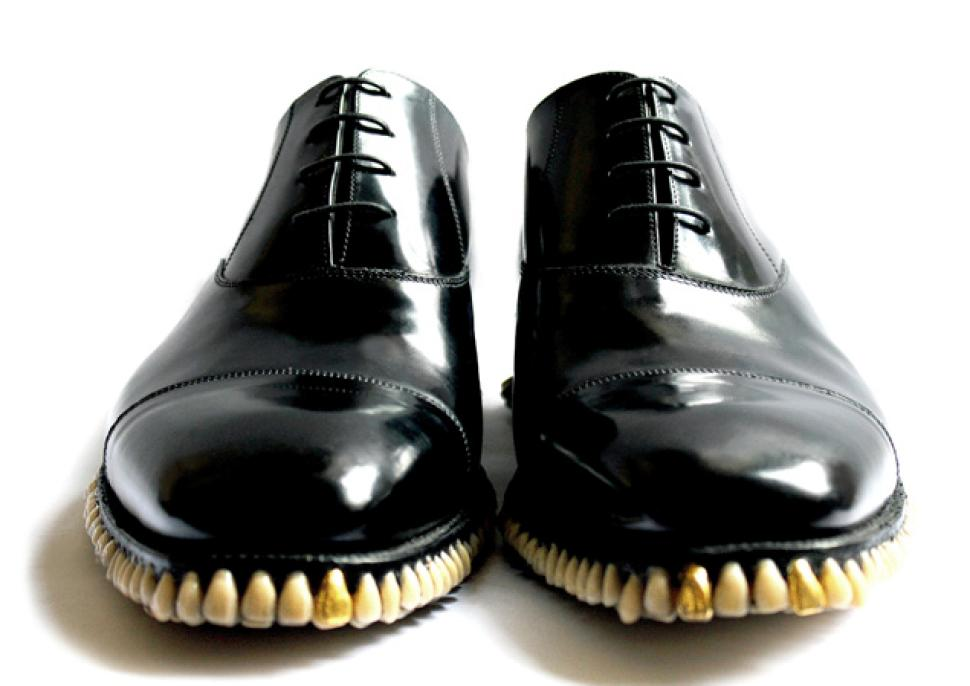 Shiny black shoes with hundreds of teeth implanted into the soles.