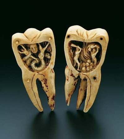 18th century French carving depicting the legend of the toothwarm destroying teeth from the inside.