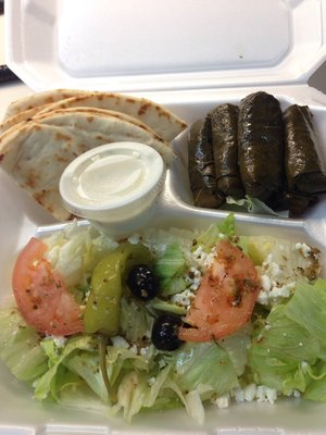 Dolmas, pita bread and a greek salad make up the Dolma Plate at Gyros To Go in Arlington, Texas.