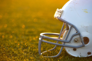 American Football Helmet on Field Backlit