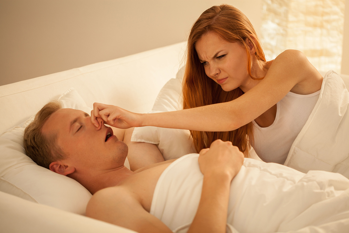 Young angry woman and her way to stop man's snoring